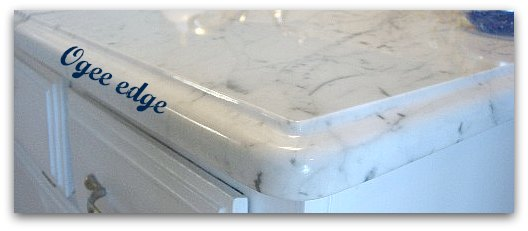 Ogee countertop edges on Carrara marble bathroom vanity