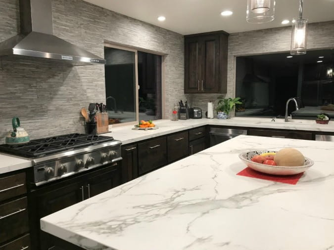 white dekton countertops that look like marble on a kitchen island