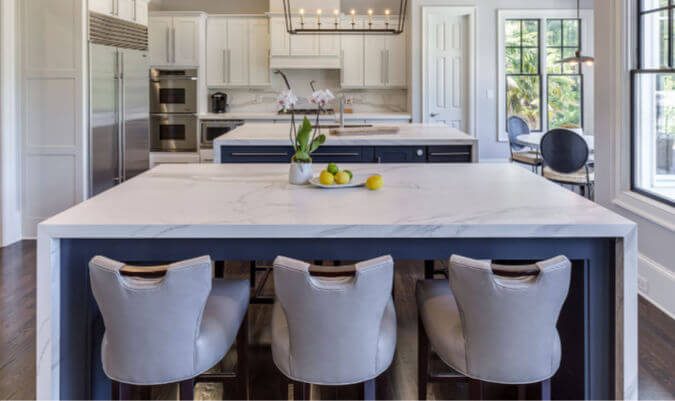 white Neolith estatuario countertops on a large luxury kitchen island