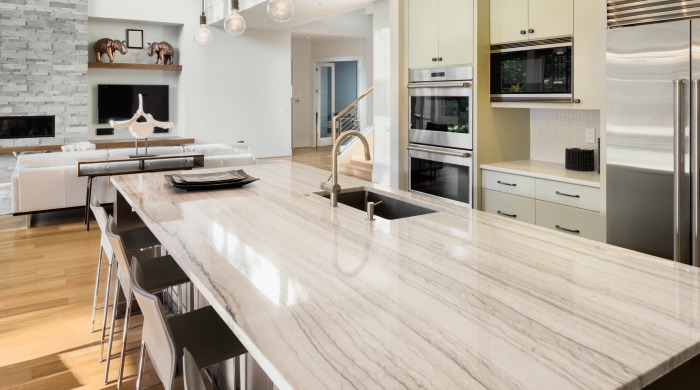 quartzite countertops white macaubus on long kitchen island in modern home