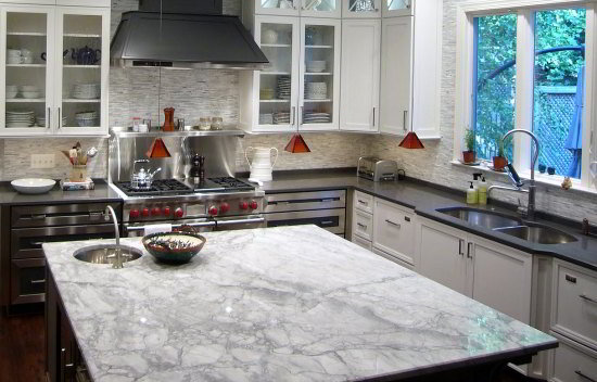 white fantasy quartzite kitchen island countertop looks like carrara marble