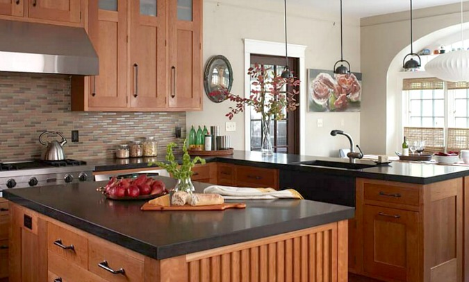 black concrete countertops on kitchen island with wood cabinets