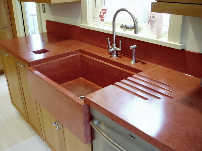 concrete countertops with custom red color and integrated sink and drainboard