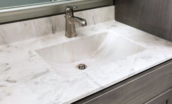 White cultured marble vanity top looks like marble