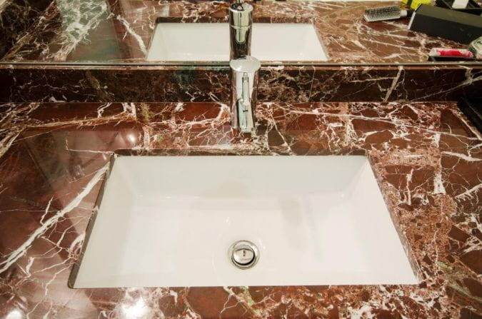 unique red polished marble bathroom countertop with white undermount sink