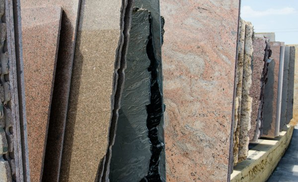 rows of granite countertop slabs for sale stacked at the stone warehouse