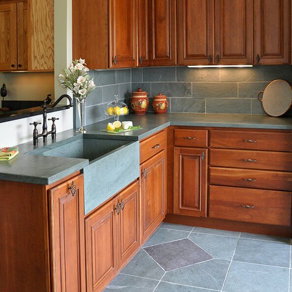 green slate countertops with integrated slate sink, slate tile backsplash and floor tile