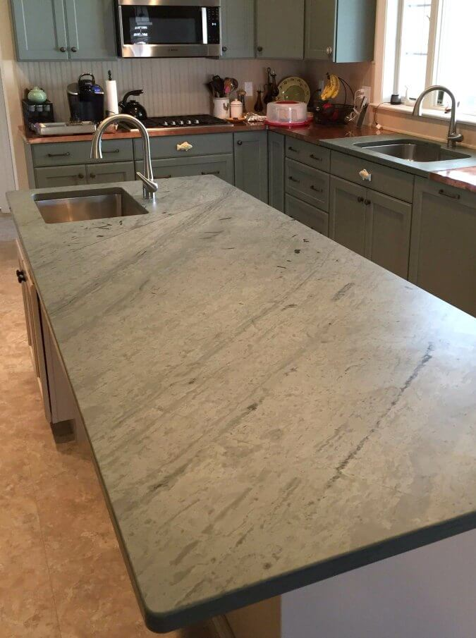 slate countertops with unique brushed pattern on kitchen island