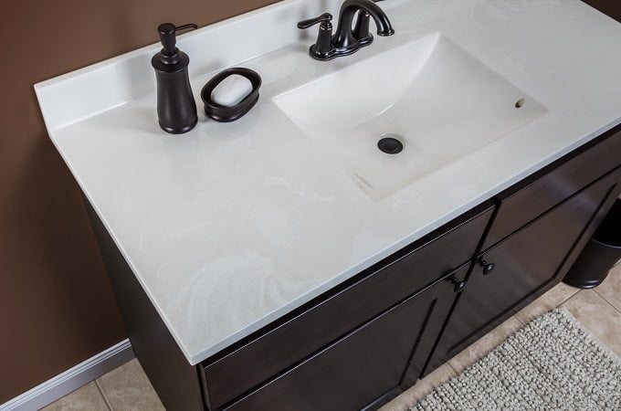 modern white cultured marble countertop with built-in sink and backsplash