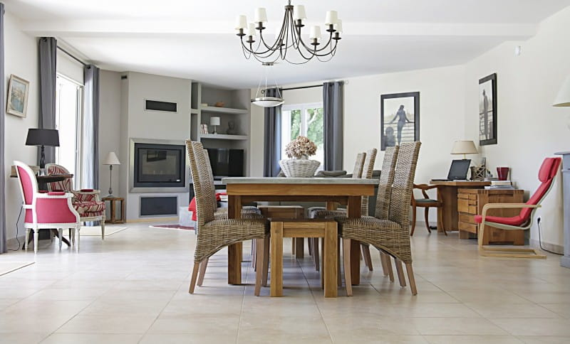 natural stone flooring ideas: travertine tile in open dining and living room