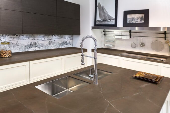 neolith ultra-compact surface type countertop - iron moss color on sleek kitchen island