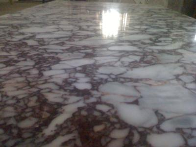 What are some tips for cleaning old marble?