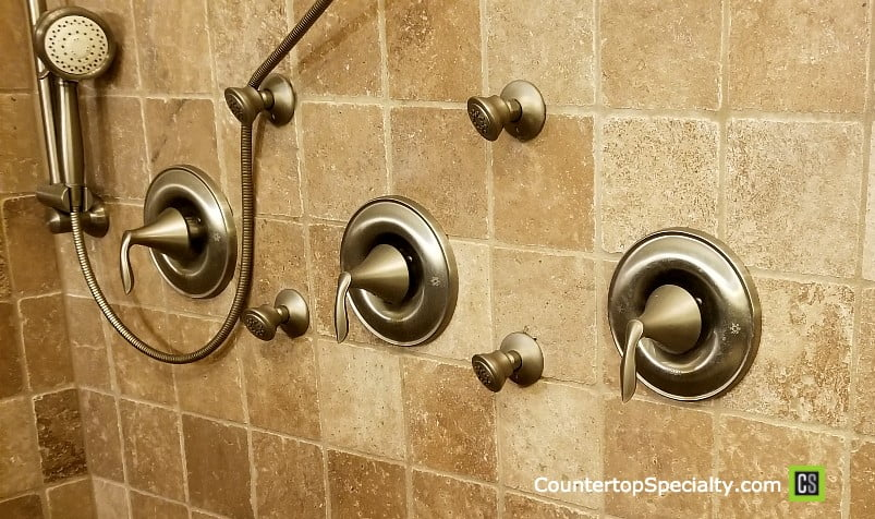 sealing travertine shower - beige travertine tile shower wall with faucets