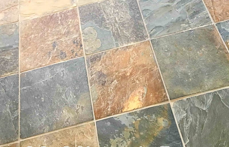 colorful slate floor tile in gold, green, rust, and tan