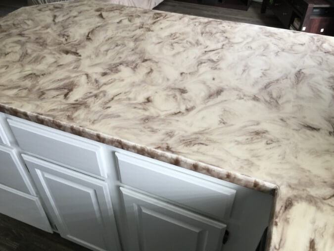 Epoxy Countertops With White And Coffee Colored Swirl Pattern In New Kitchen