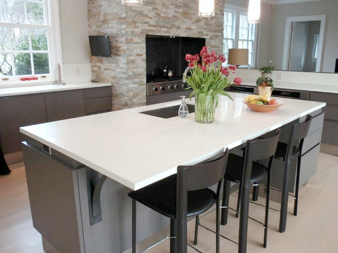 White Concrete Countertops On Kitchen Island In Modern Open Design