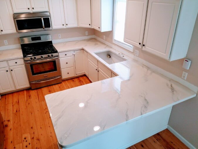 White Epoxy Countertops Look Like Carrara Marble On Cabinets With Wood Floor