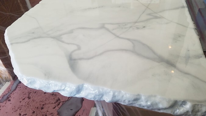 white epoxy countertops that look like marble with a chiseled edge